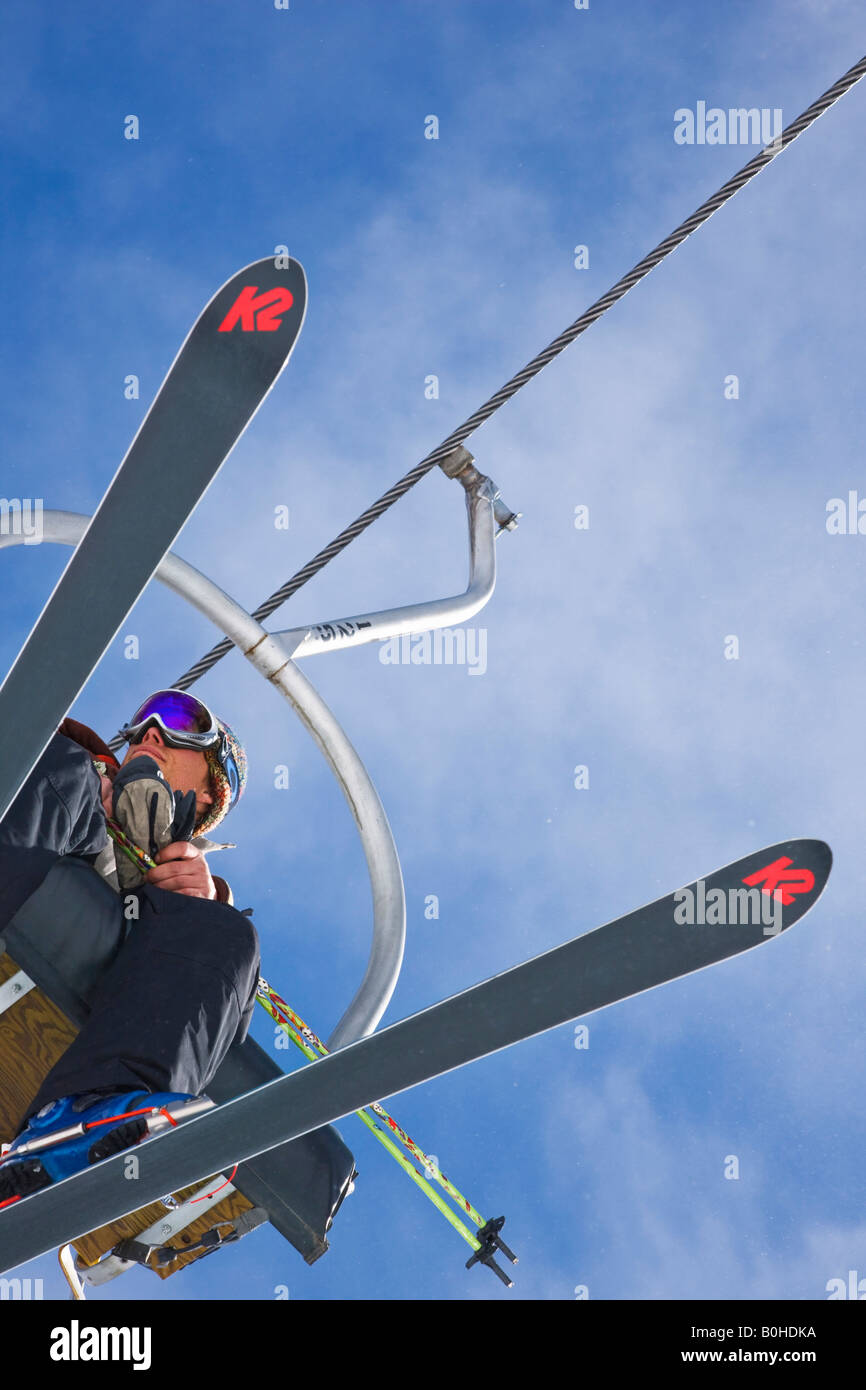 Skier on a chairlift at Telluride Ski Resort, Colorado, USA. - Stock Image