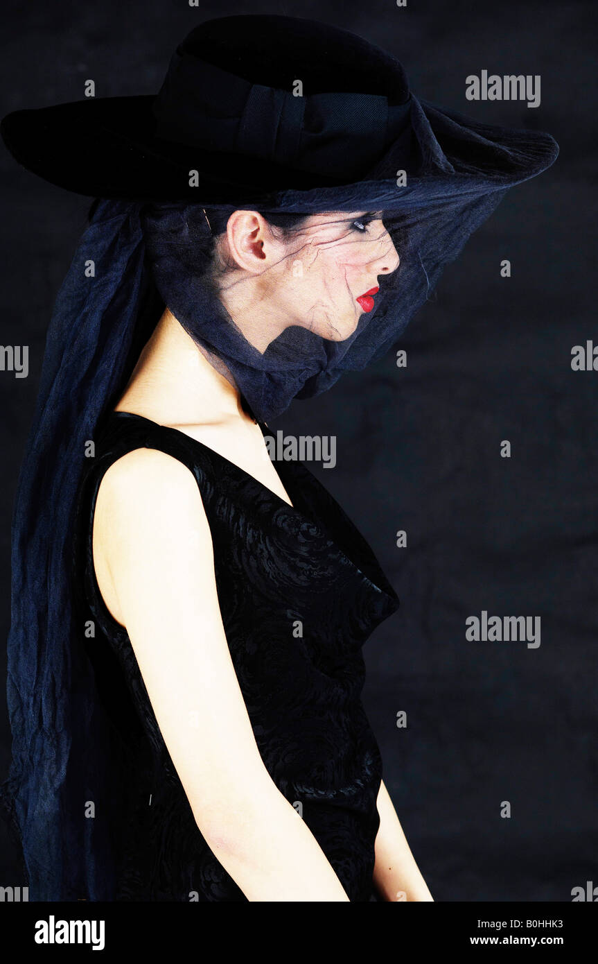 Young woman wearing black and a veil, widow - Stock Image