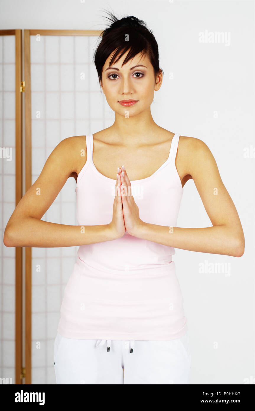 Young woman relaxing, meditating - Stock Image