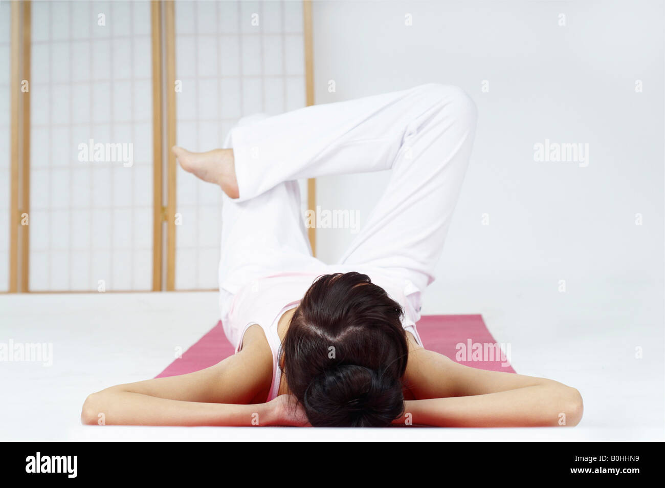 Young woman relaxing and meditating Stock Photo