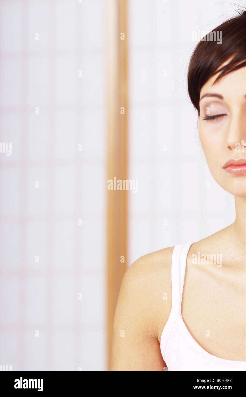 Young woman relaxing and meditating, eyes closed Stock Photo