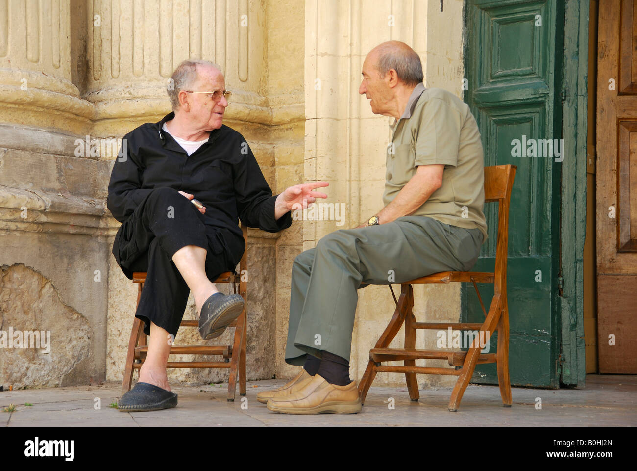 Two old men chatting, Lecce, Apulia, South Italy, Italy, Europe - Stock Image