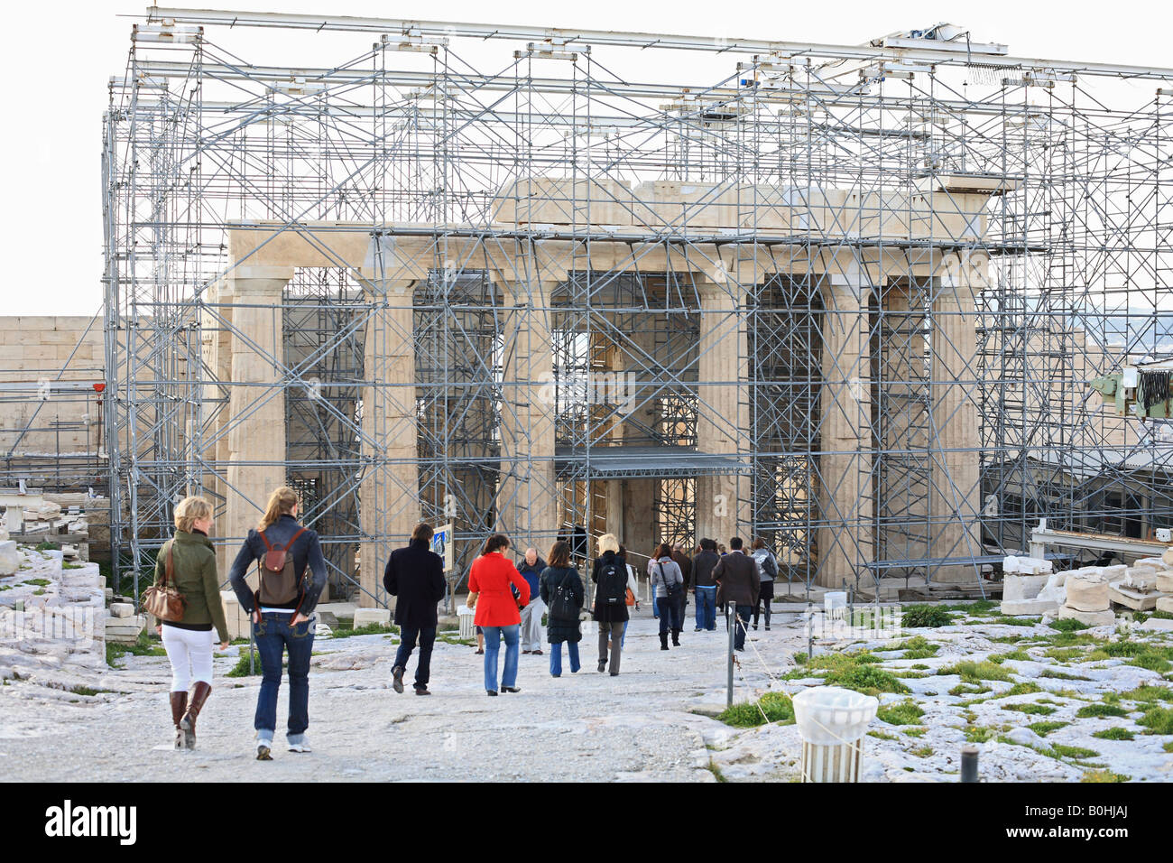 Tour group guided through the Acropolis covered in scaffolding, Athens, Greece - Stock Image