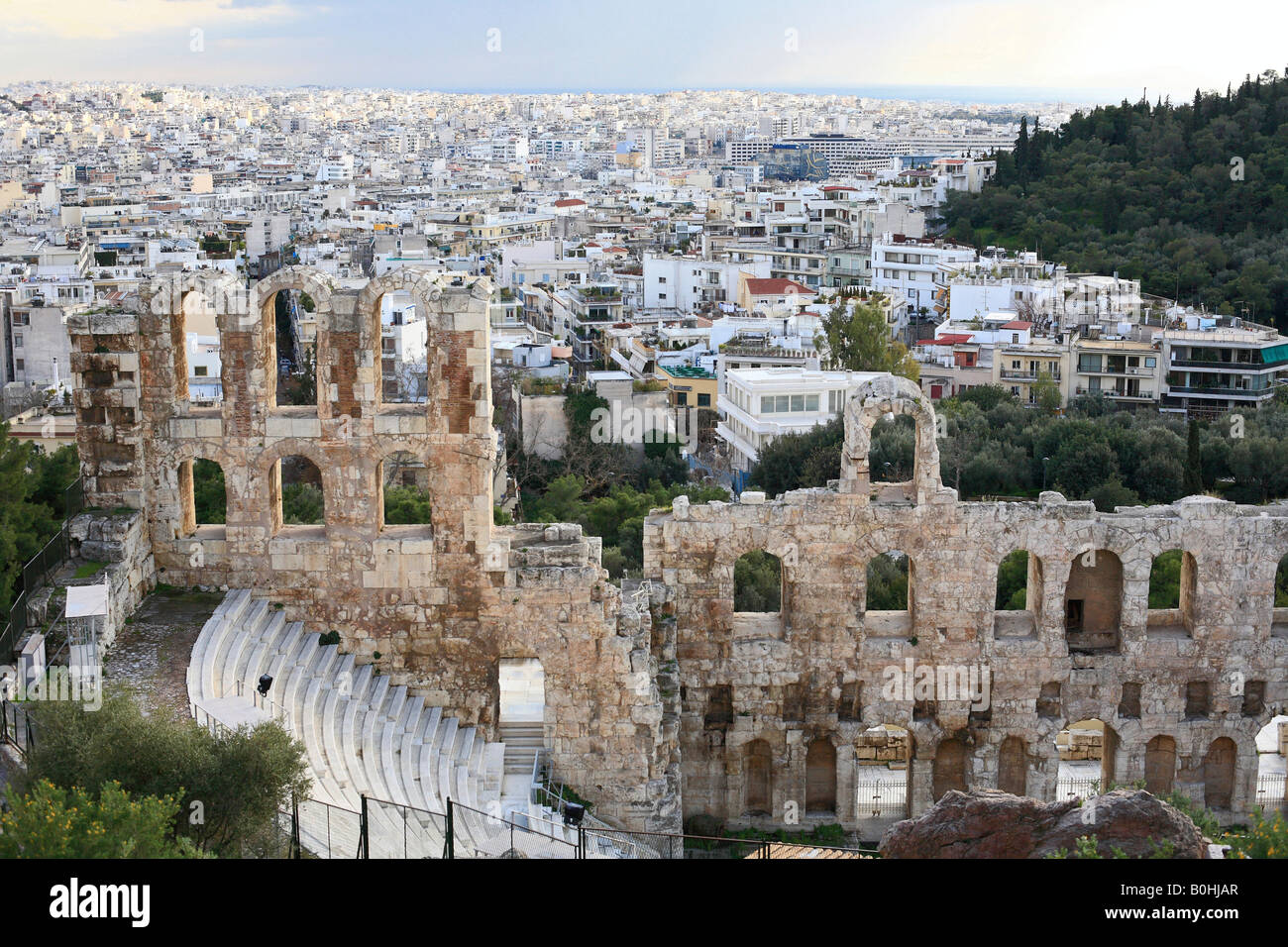 Odeon of Herodes Atticus, ancient ruins of the Acropolis overlooking sprawling city of Athens, Greece - Stock Image
