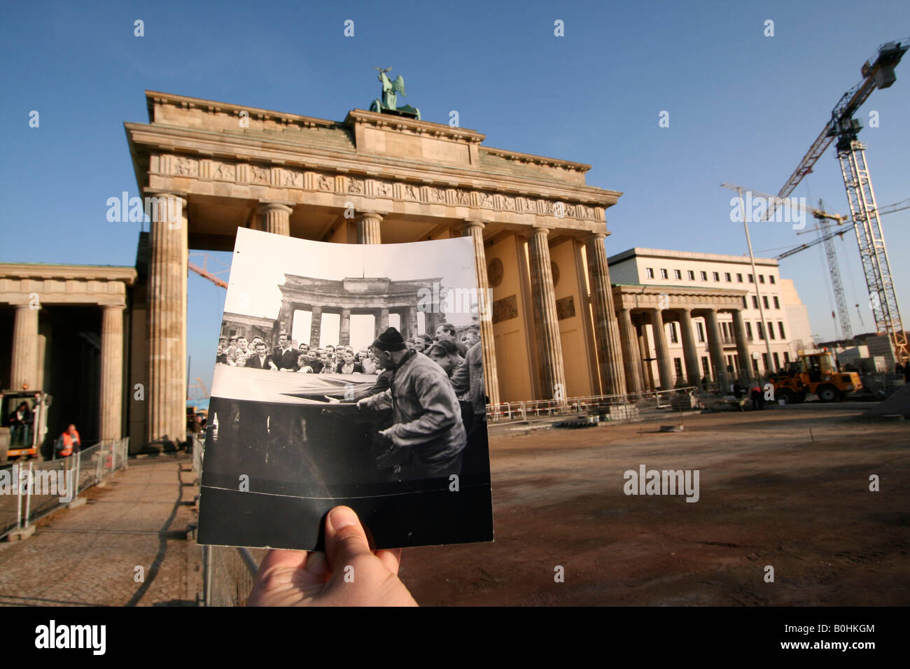 Then And Now Hand Holding An Old Black And White Photo Of A Worker S Stock Photo Alamy