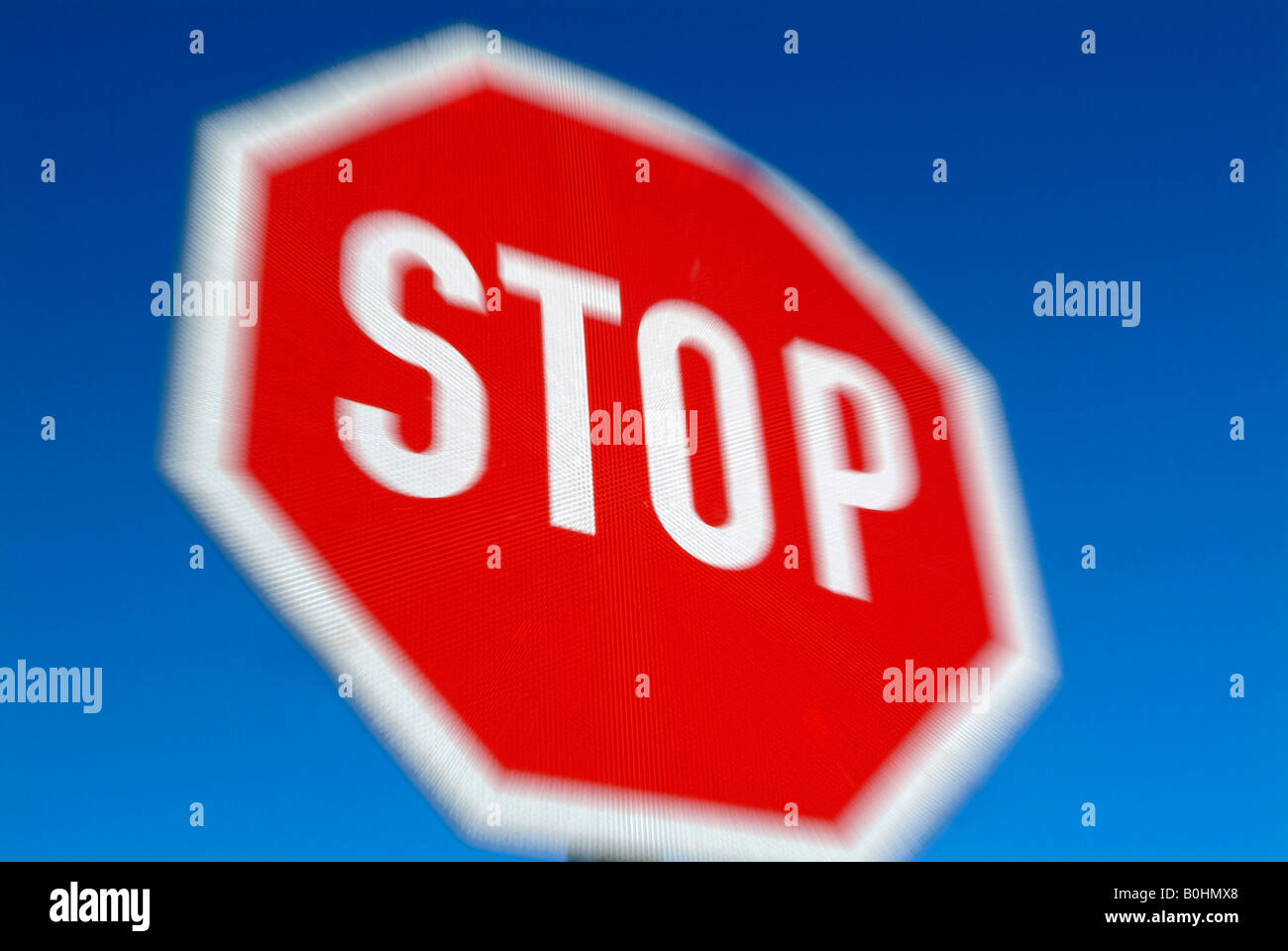 Zoomed, blurry, unfocused stop sign, Austria - Stock Image