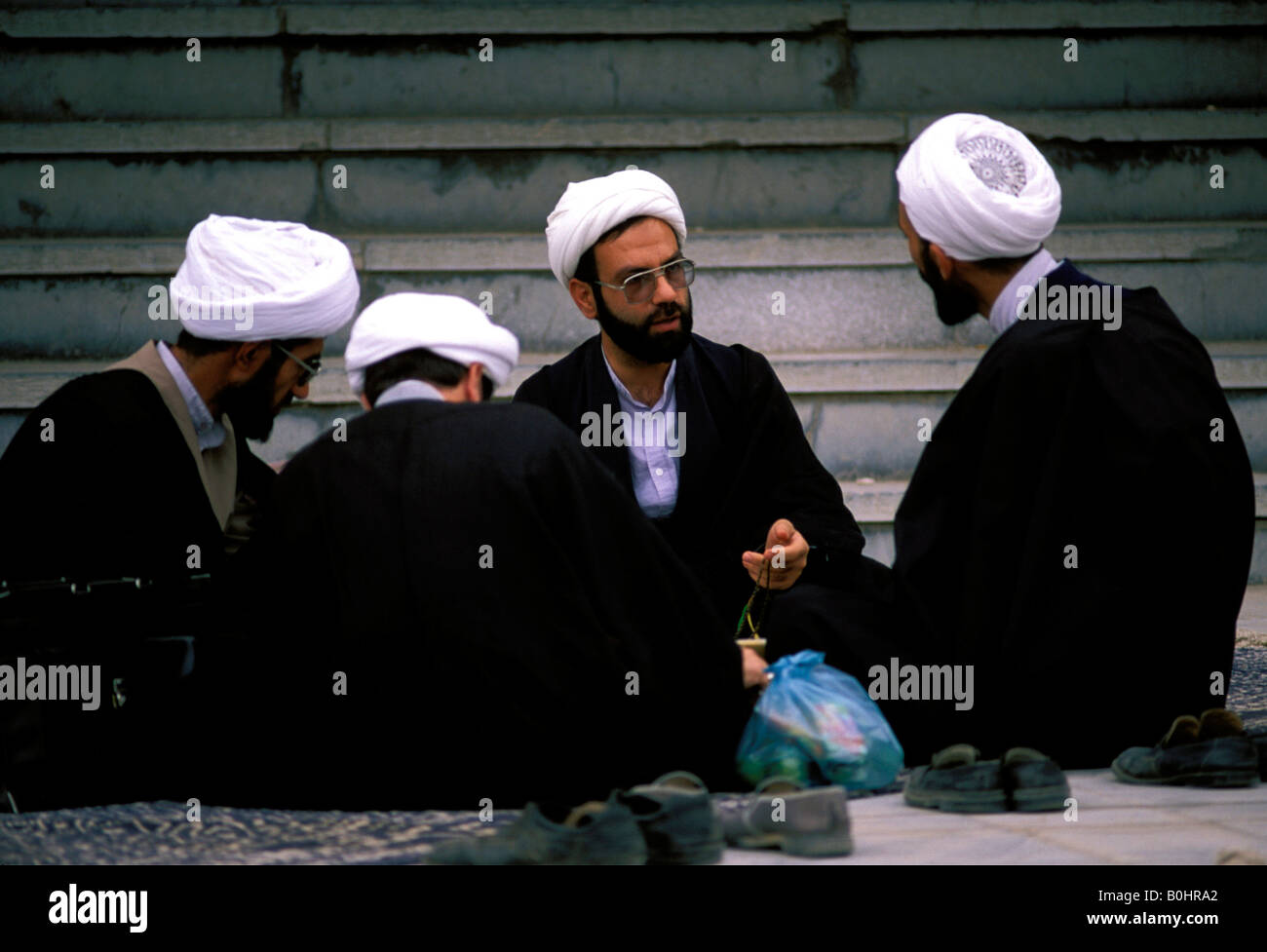 Scholars talking outside the Faizieh Theology College, Qom, Iran. - Stock Image
