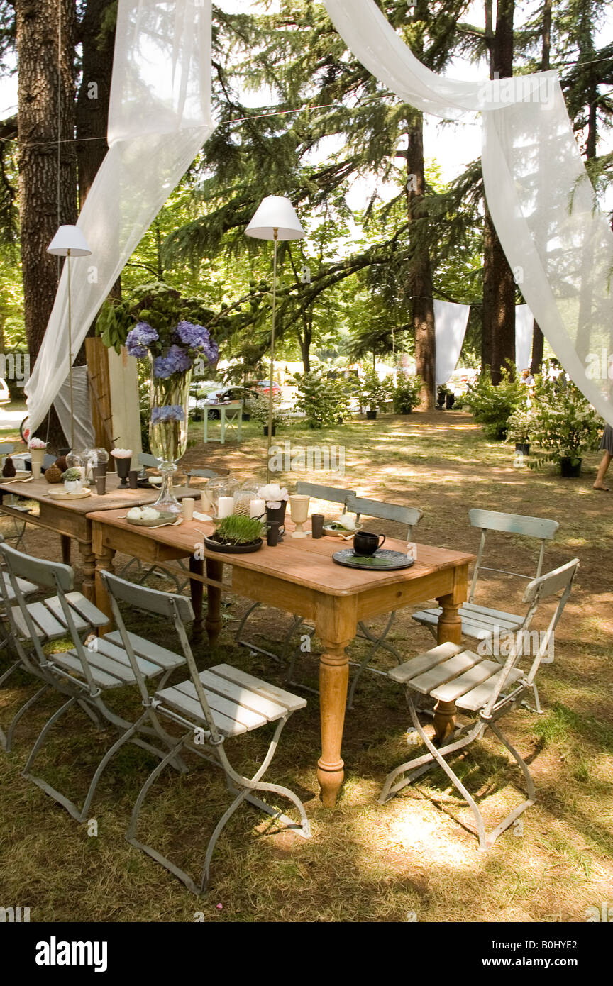 furniture rustic garden of for countryside house green gar ceremony tables outdoor photo wedding stacked guests lawn in