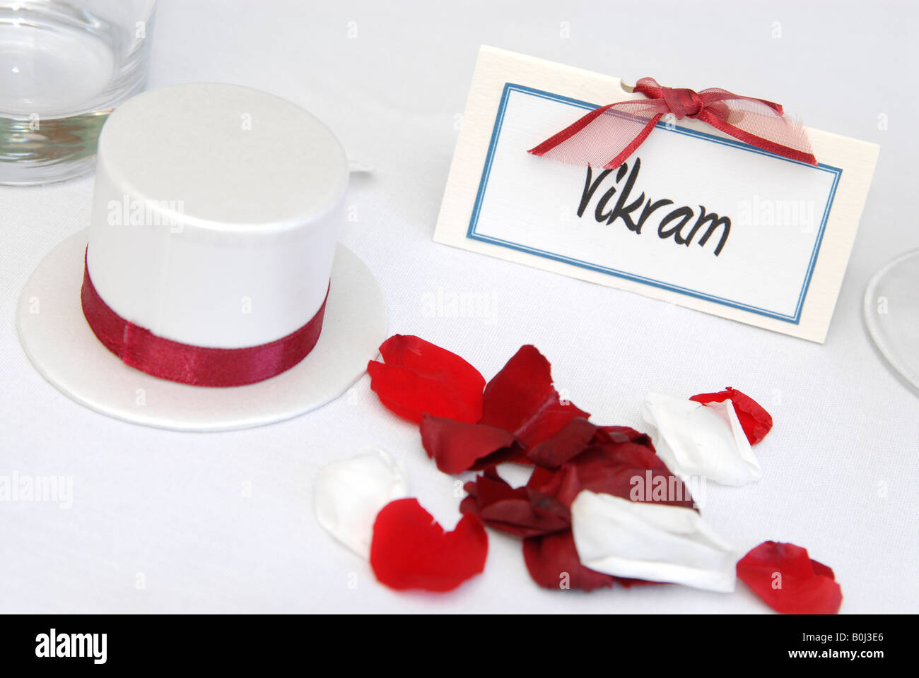 A red and white top hat wedding favour on a table at a wedding Stock ...