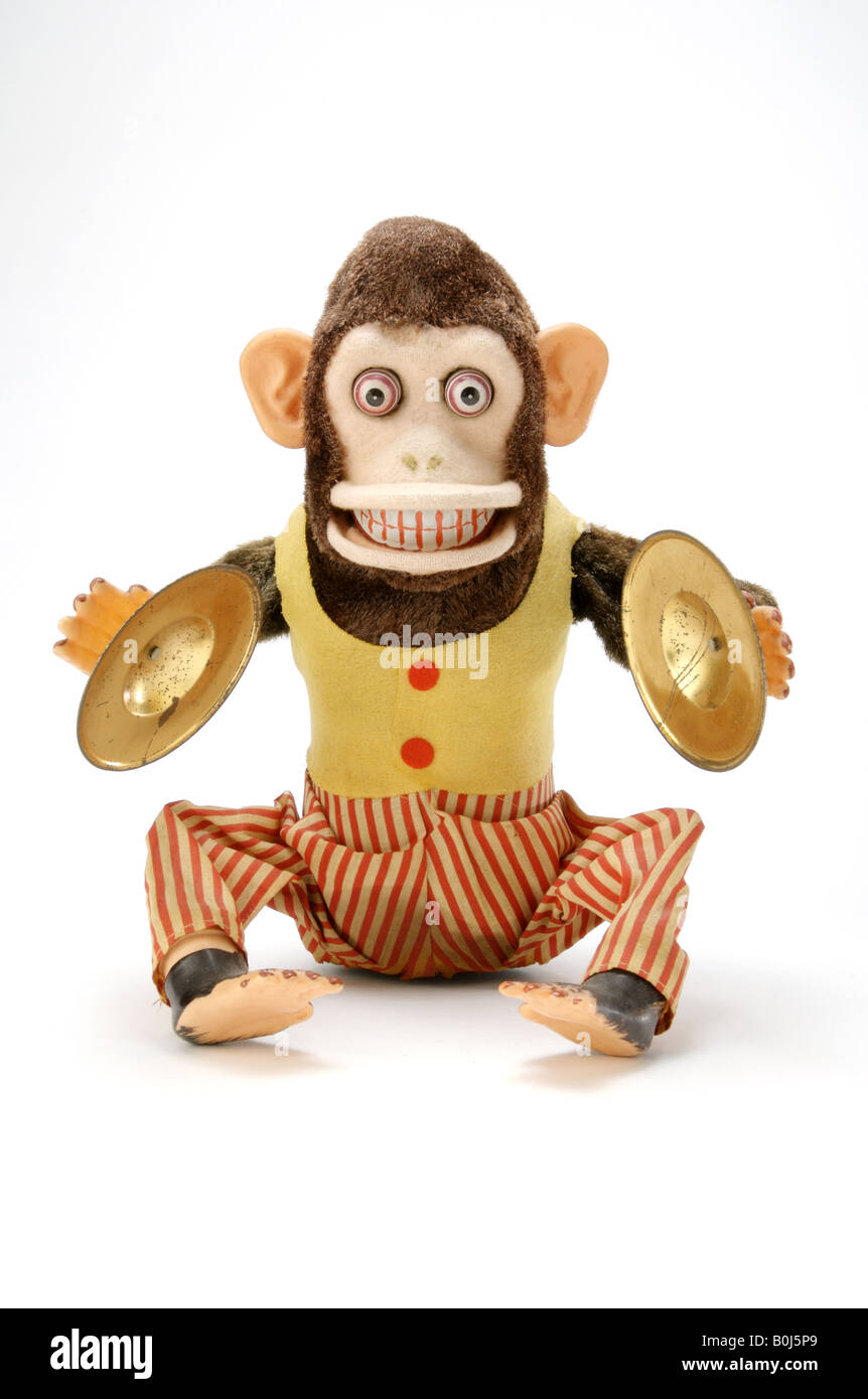 An antique childrens toy monkey that make noise - Stock Image