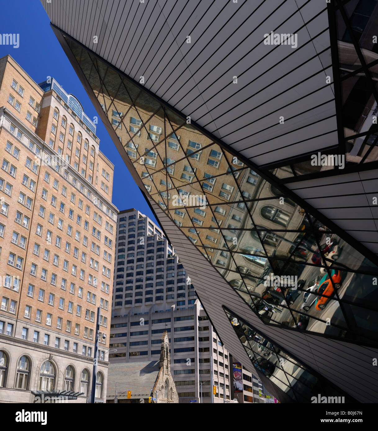 Reflections of Toronto buildings in the modern glass Crystal addition to the Royal Ontario Museum - Stock Image