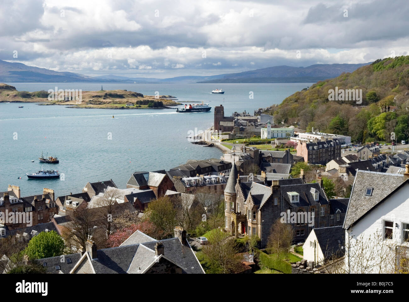 View over Oban, towards Mull, with the Cathedral shown near the ferry boat Stock Photo
