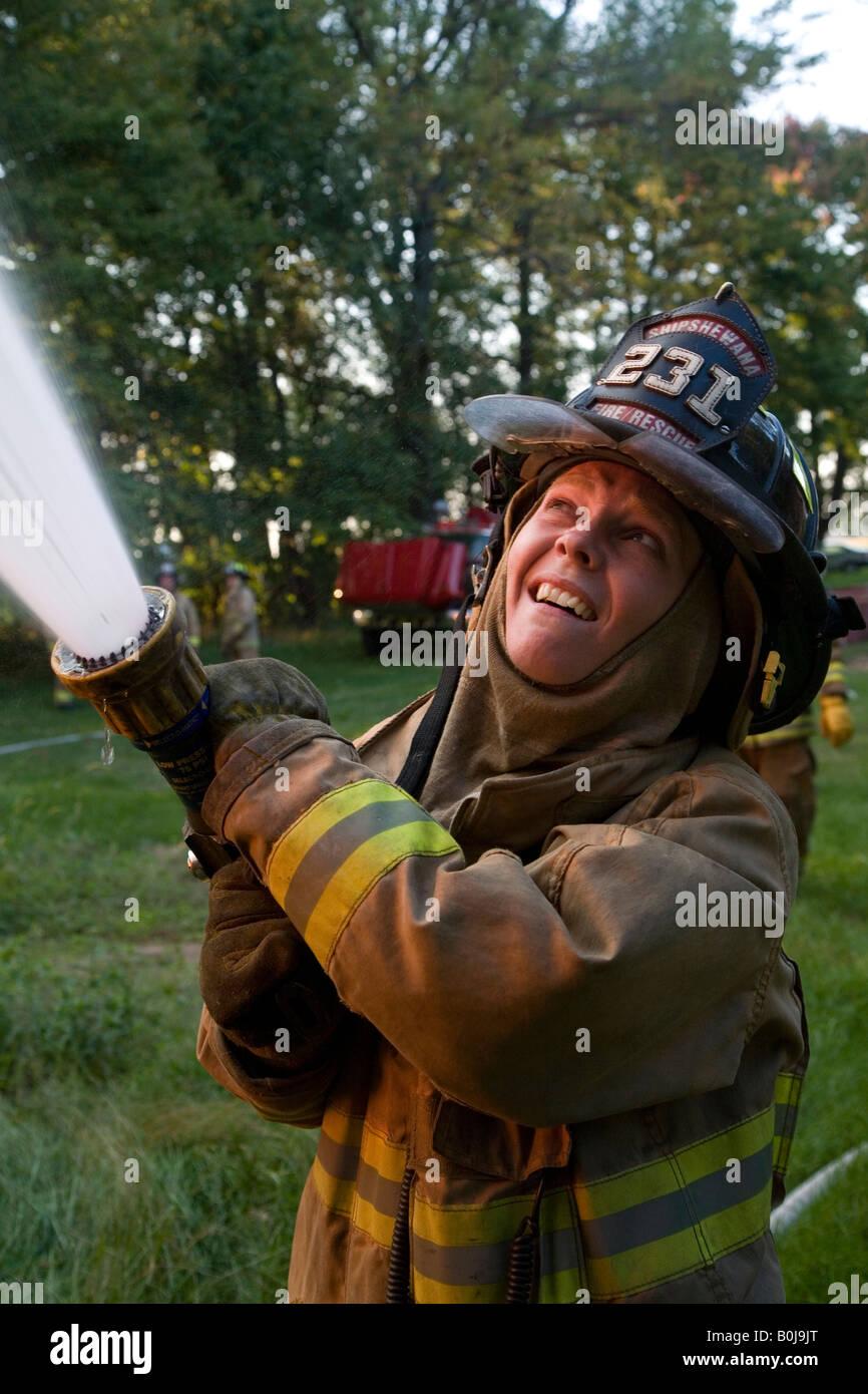 Female Volunteer Firefighter - Stock Image