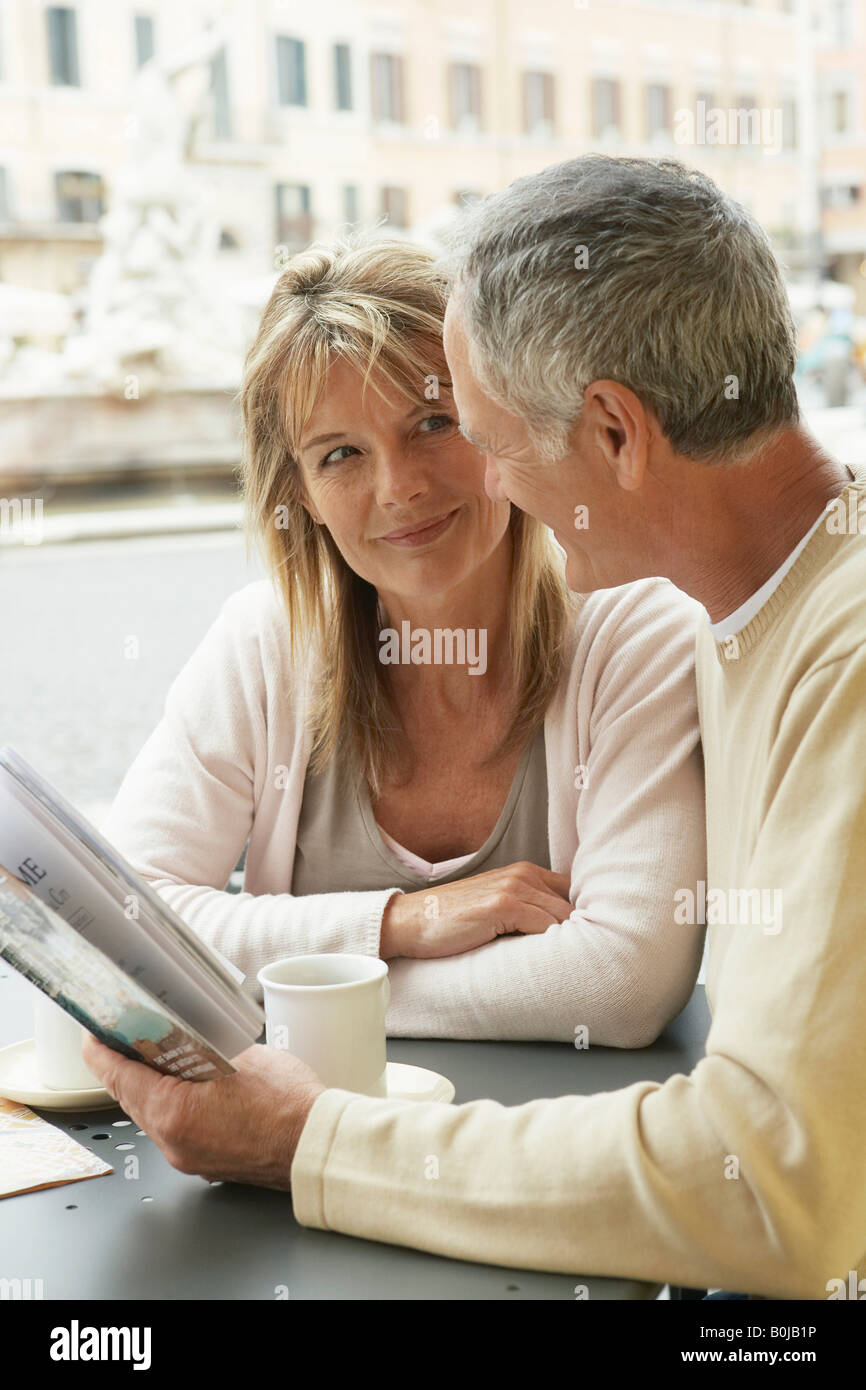 Tourist Couple in Cafe - Stock Image