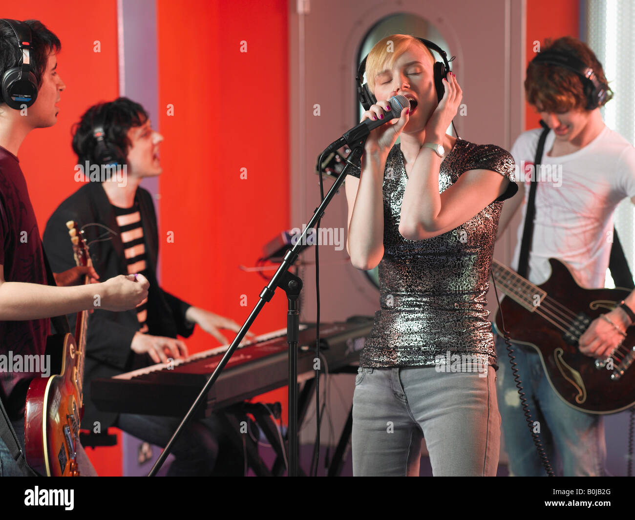 Rock Band Performing in Studio - Stock Image