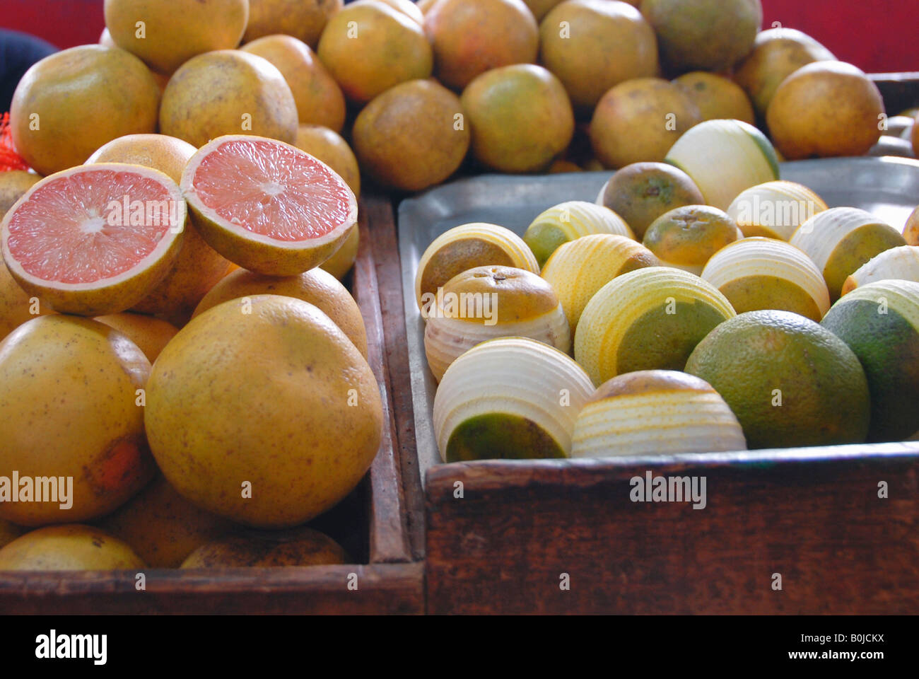 Fresh grapefruits and lemons on sale at an indoor marketplace - Stock Image