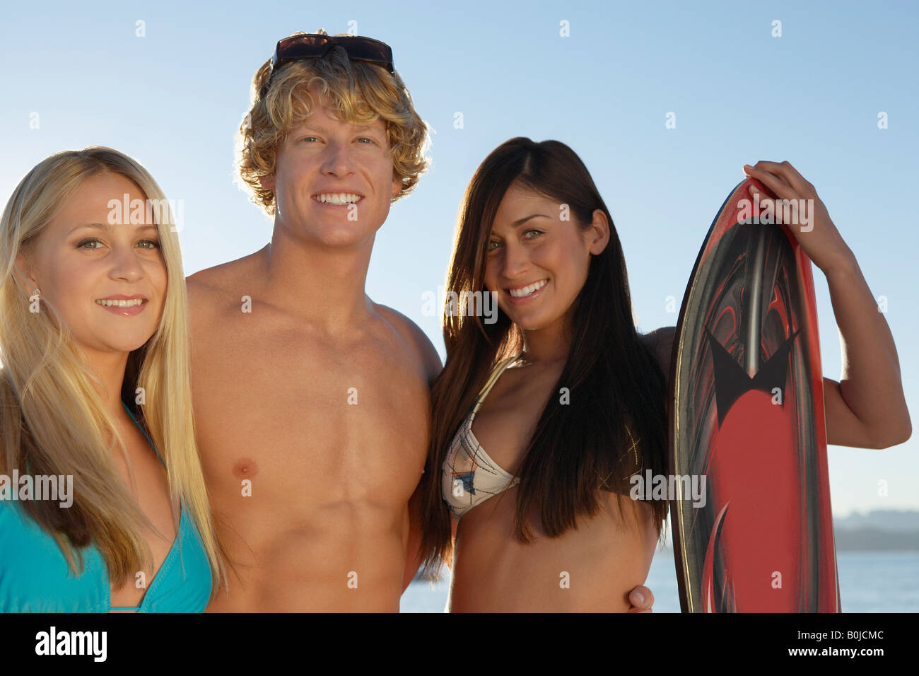 Young friends in swimwear outdoors, portrait - Stock Image