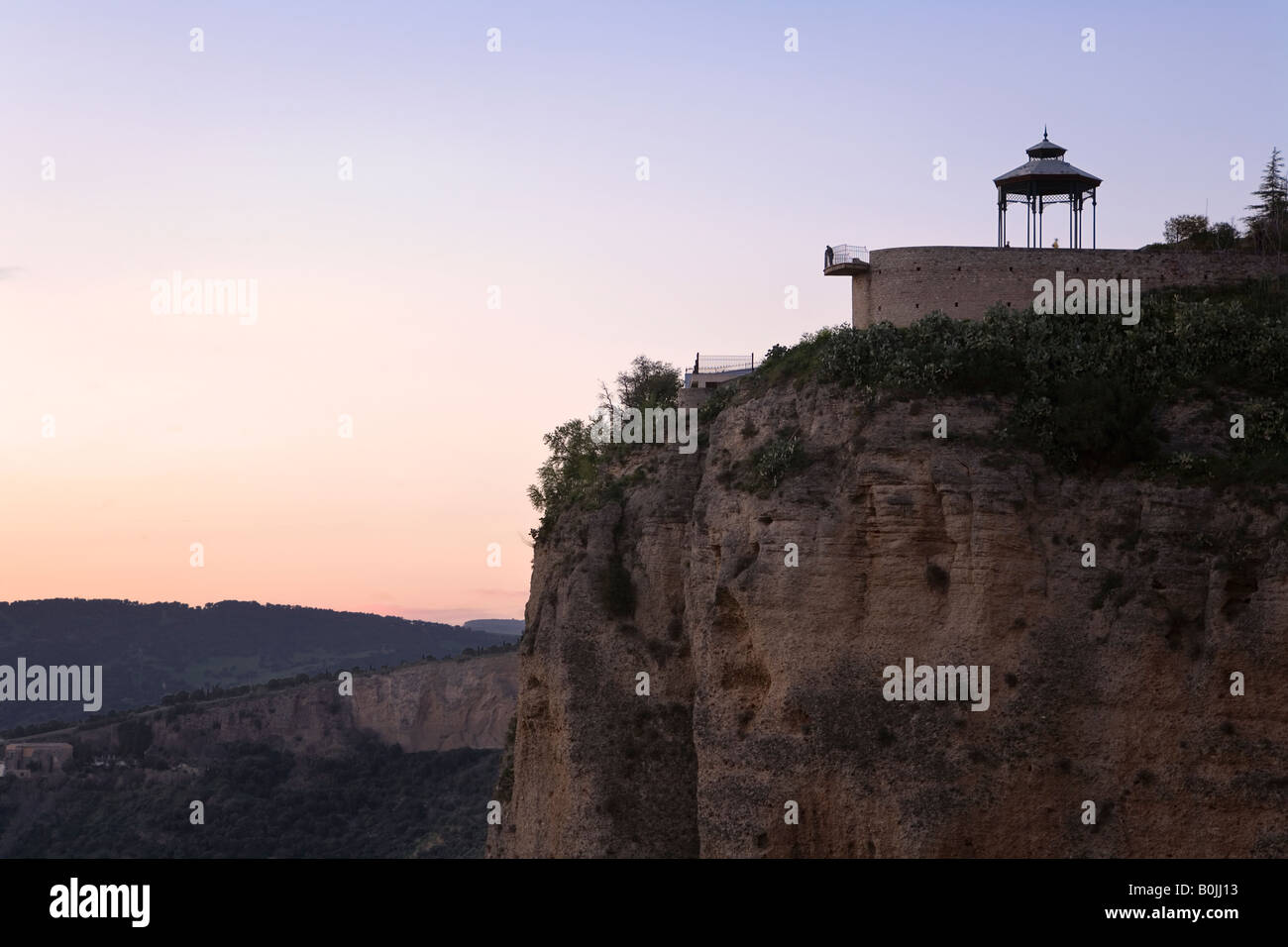 Ronda, Andalusia, Spain. Mirador at Blas Infante Promenade overlooking El Tajo gorge. Sunset Stock Photo