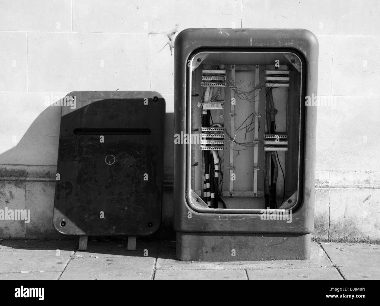 A disused telephone exchange box left with its front panel off on a street in Clacton. - Stock Image