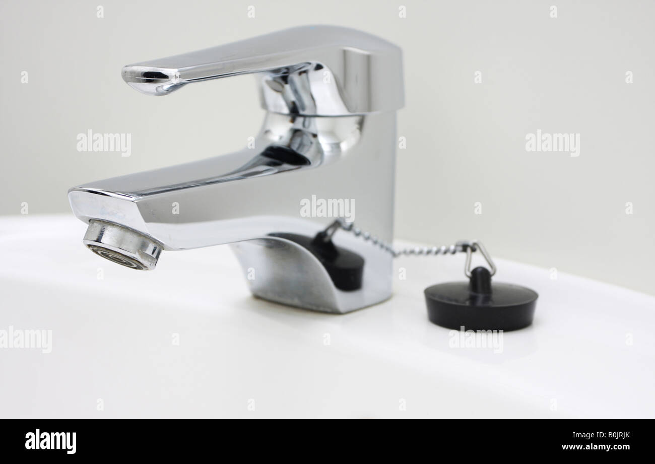 chrome faucet on a sink no running water - Stock Image