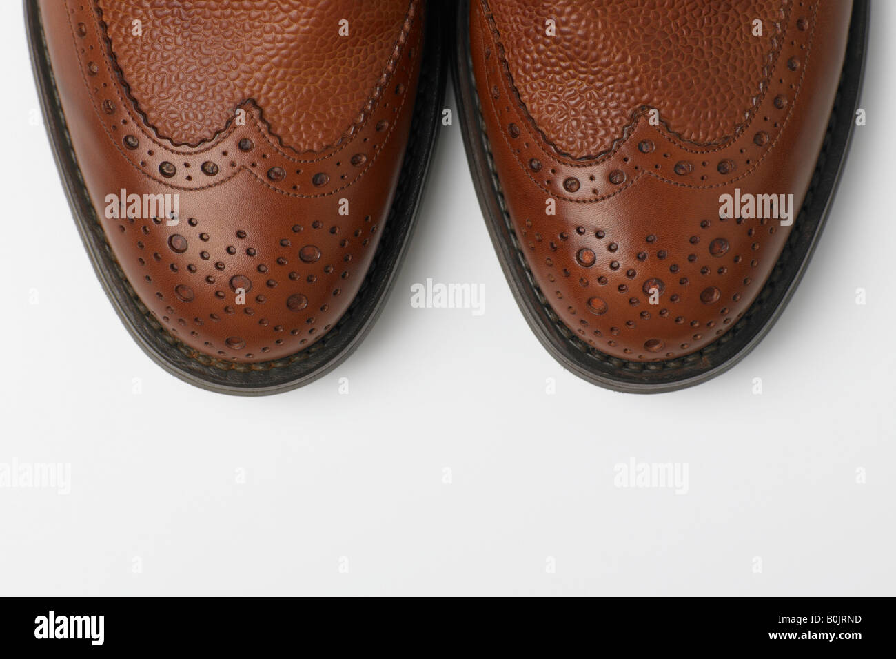 tips of brown brouge shoes - Stock Image