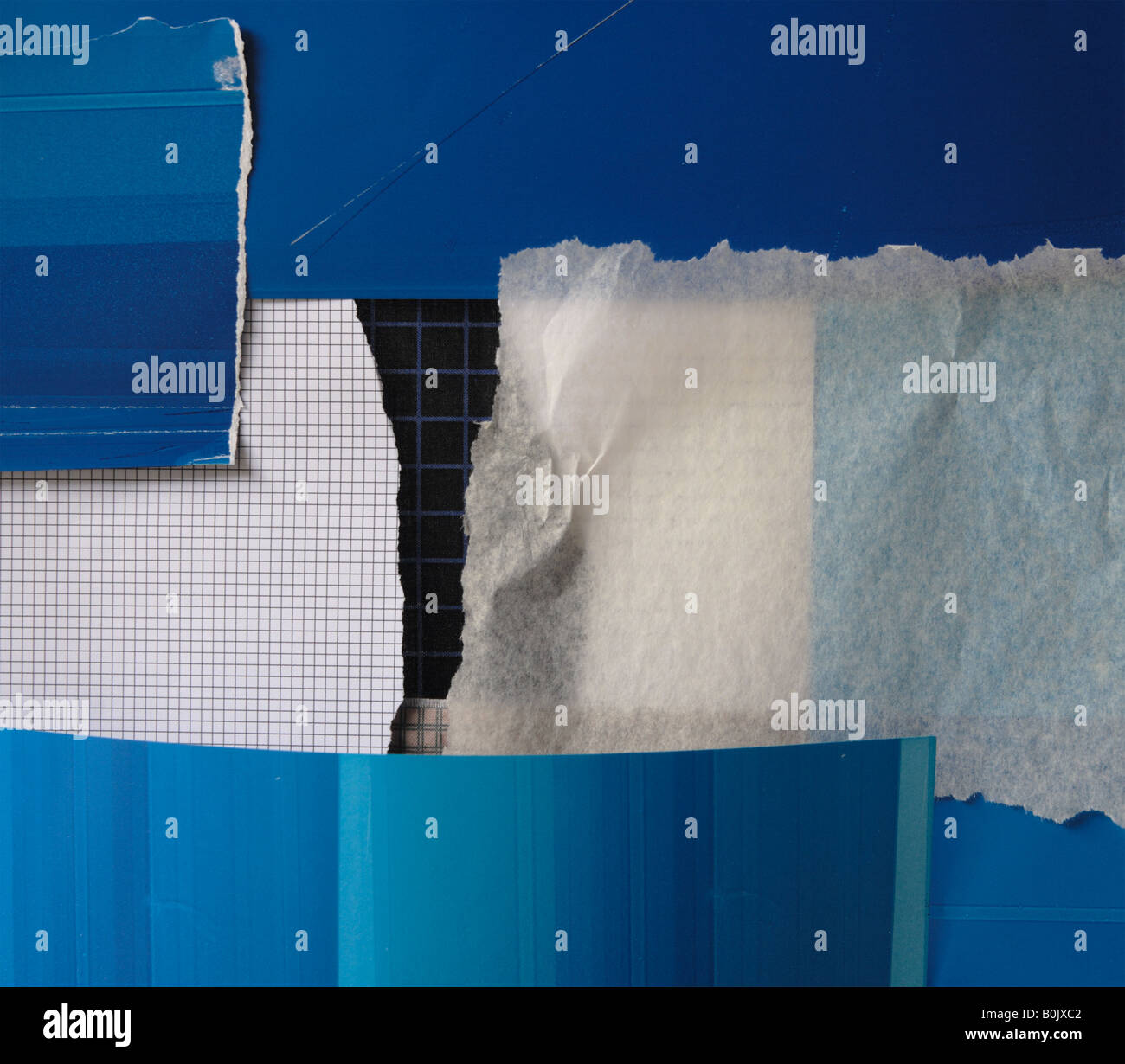 collage background of paper and fabric in blue, black and neutral colors - Stock Image