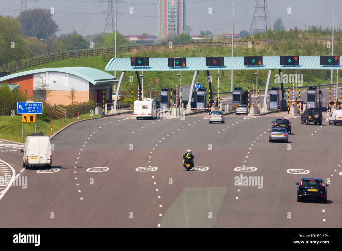 M6 TOLL MOTORWAY from above with vehicles approaching toll booths West Midlands England UK - Stock Image