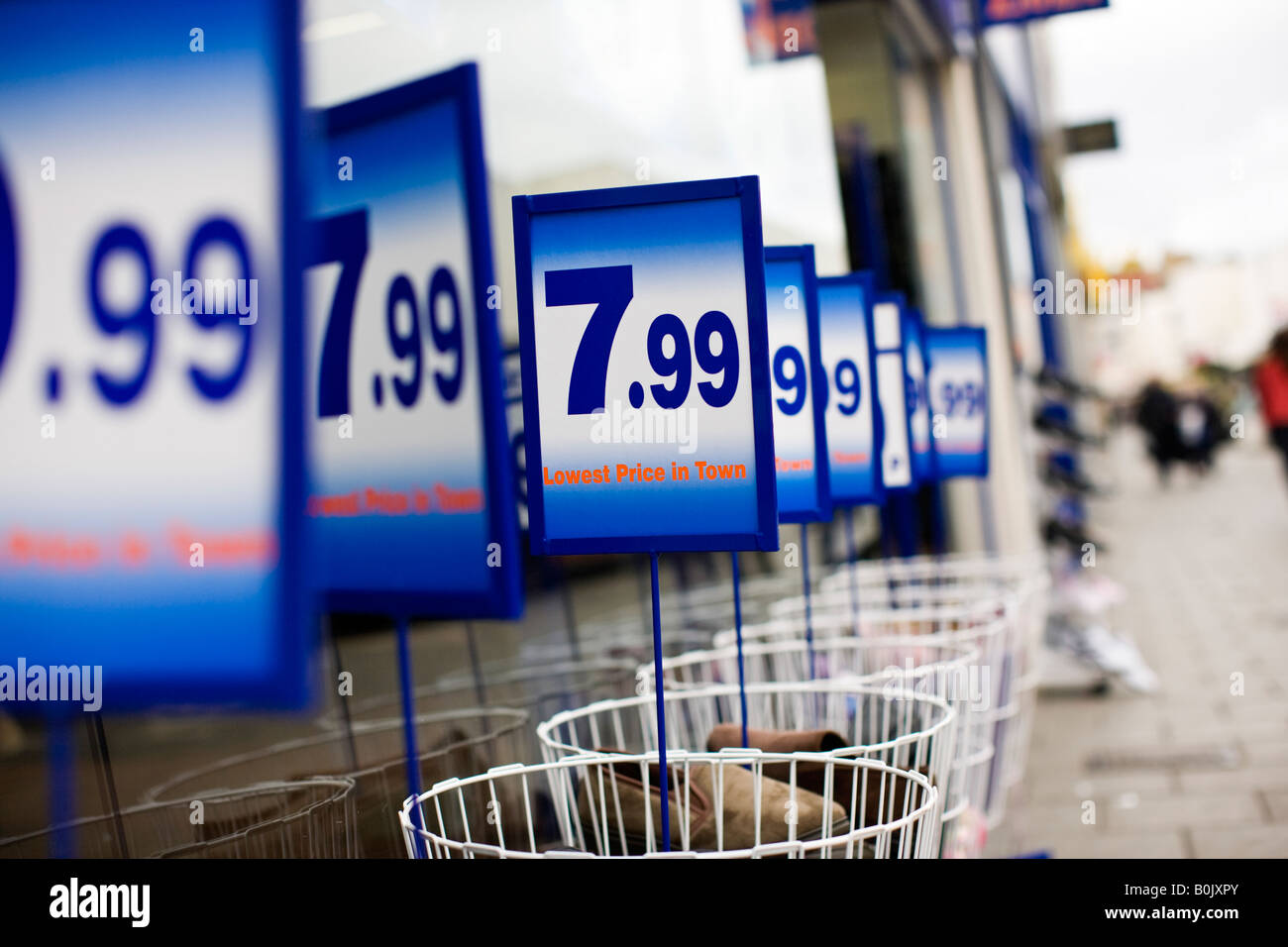 Prices on bargain bins outside a discount shoe shop, UK - Stock Image