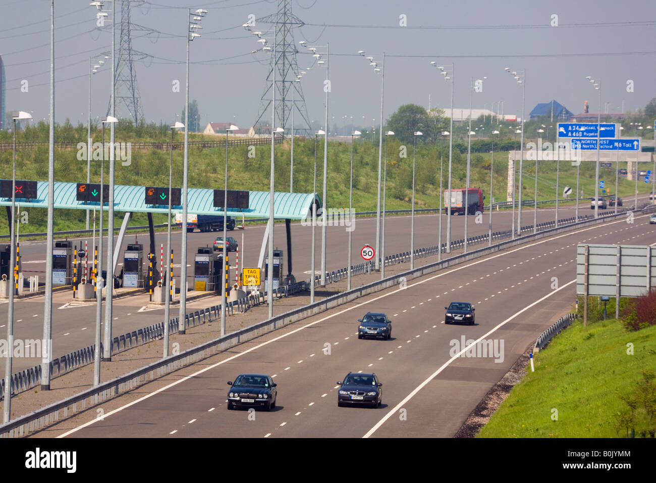 M6 TOLL MOTORWAY from above with toll booths and vehicles on carriageway West Midlands England UK - Stock Image