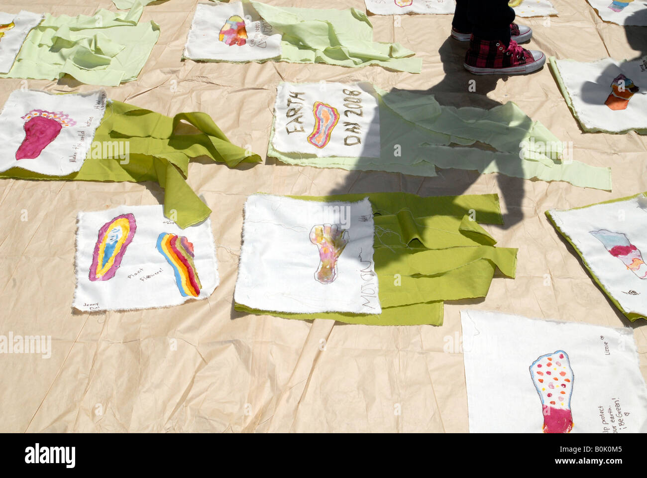 Reduce Your Carbon Footprint Parade Scroll at the NYU Earth Day street fair - Stock Image