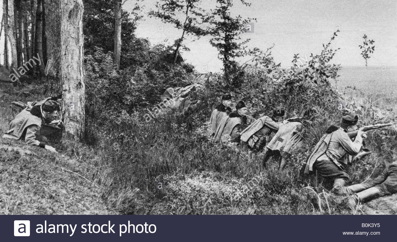 Vanguard of Austro-Hungarian Uhlans occupying a clearing in a forest, World War I, 1917. - Stock Image