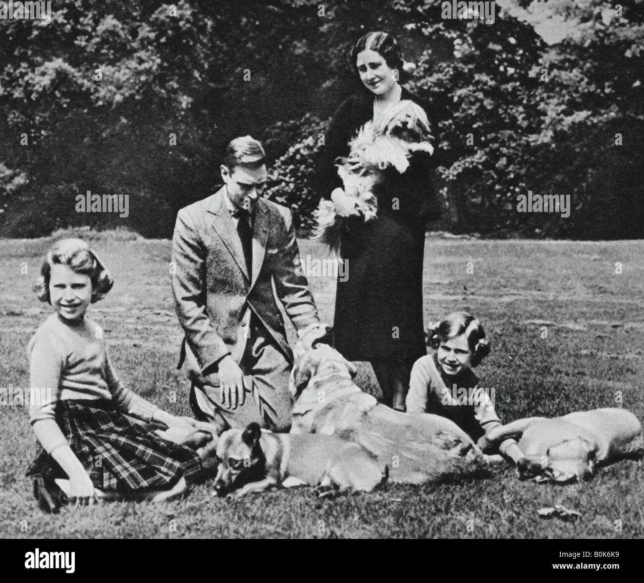 Royal family as a happy group of dog lovers, 1937. Artist: Michael Chance - Stock Image