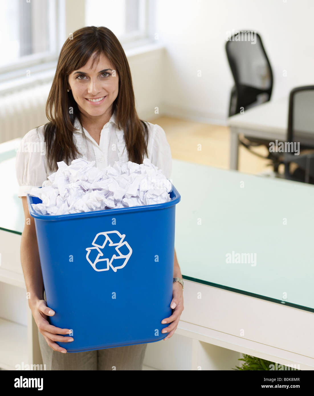 Mid-Adult Woman Holding Paper Recycling Bin Stock Photo