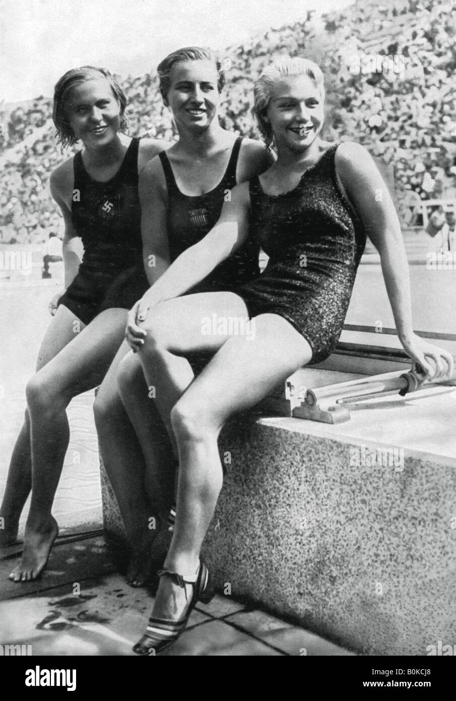 Medallists from the women's platform diving event, Berlin Olympics, 1936. Artist: Unknown - Stock Image