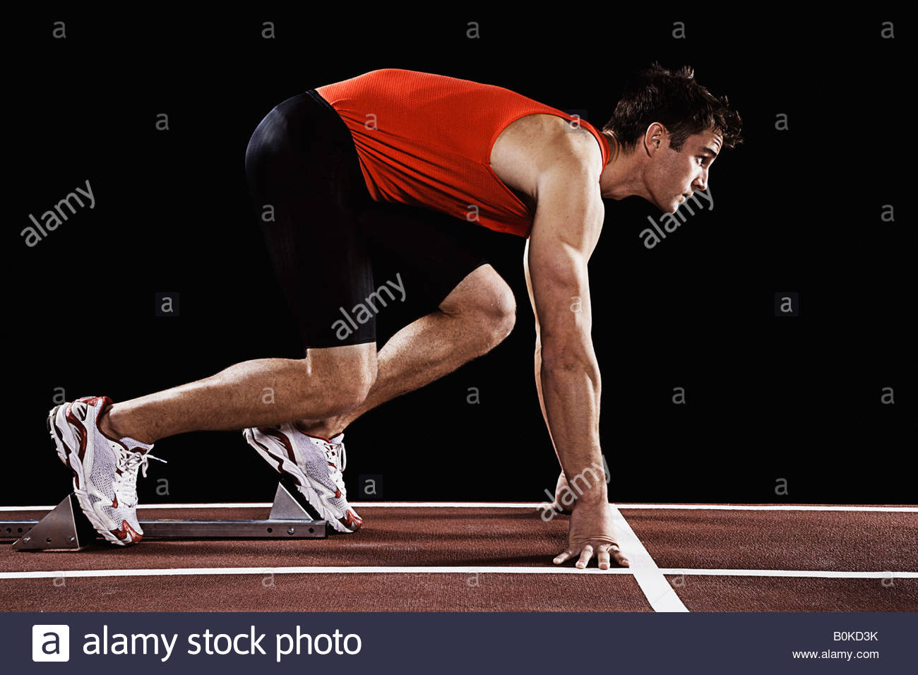 Runner on race track at his mark - Stock Image