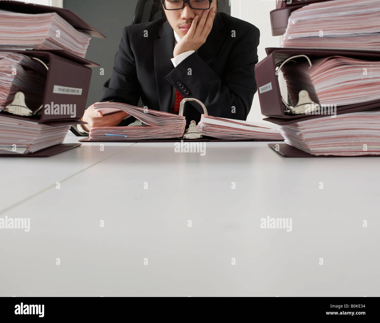 Office Worker Reading Documents Stock Photo