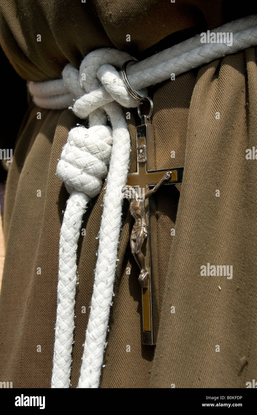 Friar's habit with cord belt and crucifix - Stock Image
