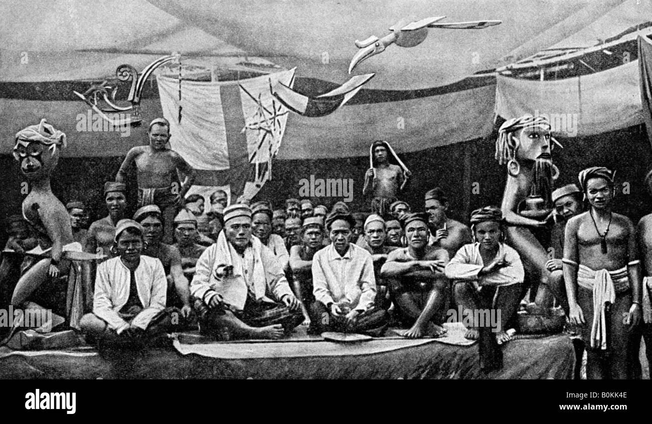 Traditional enemies assembled at a peace conference in Claudetown, Sarawak, c1899, (1922). Artist: Dr Charles Hose - Stock Image