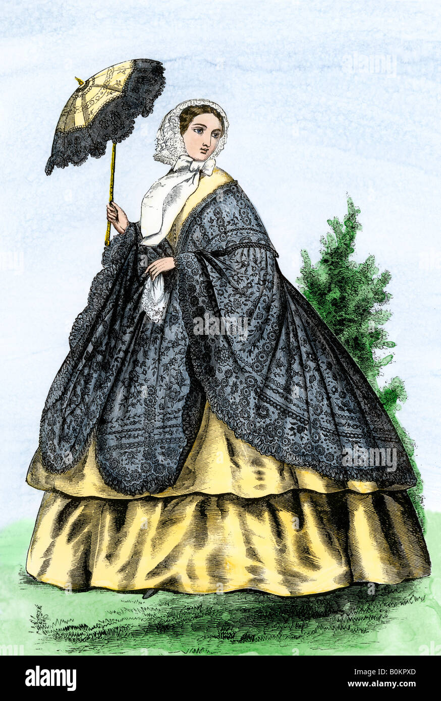 Woman in a promenade dress and shawl US 1860s. Hand-colored woodcut - Stock Image