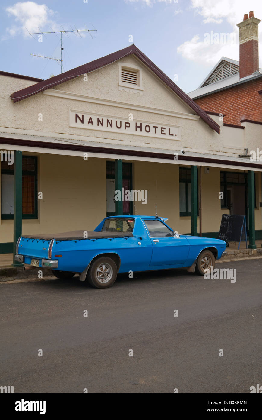 An old blue Holden Ute parked outside a traditional country town pub, Nannup, Western Australia - Stock Image