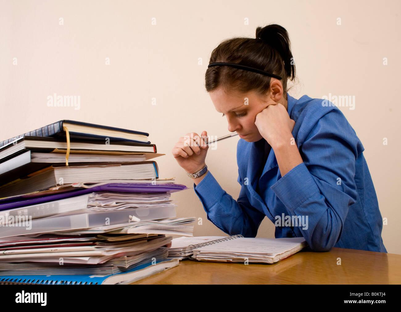 Girl studying for fer exams - Stock Image