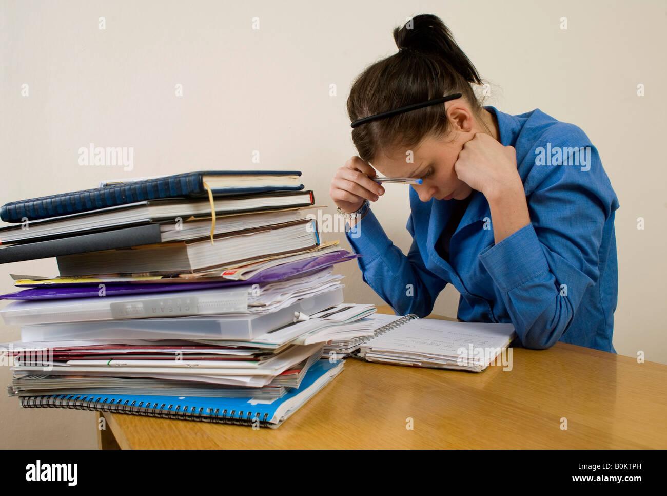 Girl, woman studying for exams - Stock Image