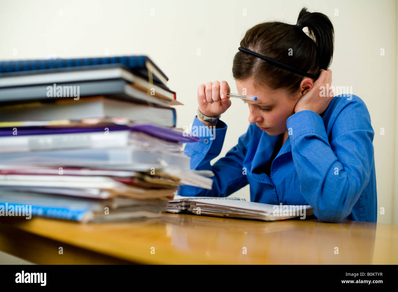 Girl, woman, studying for exams - Stock Image