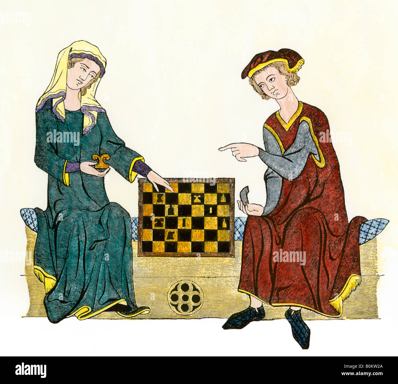Chess players in the Middle Ages. Hand-colored woodcut - Stock Image