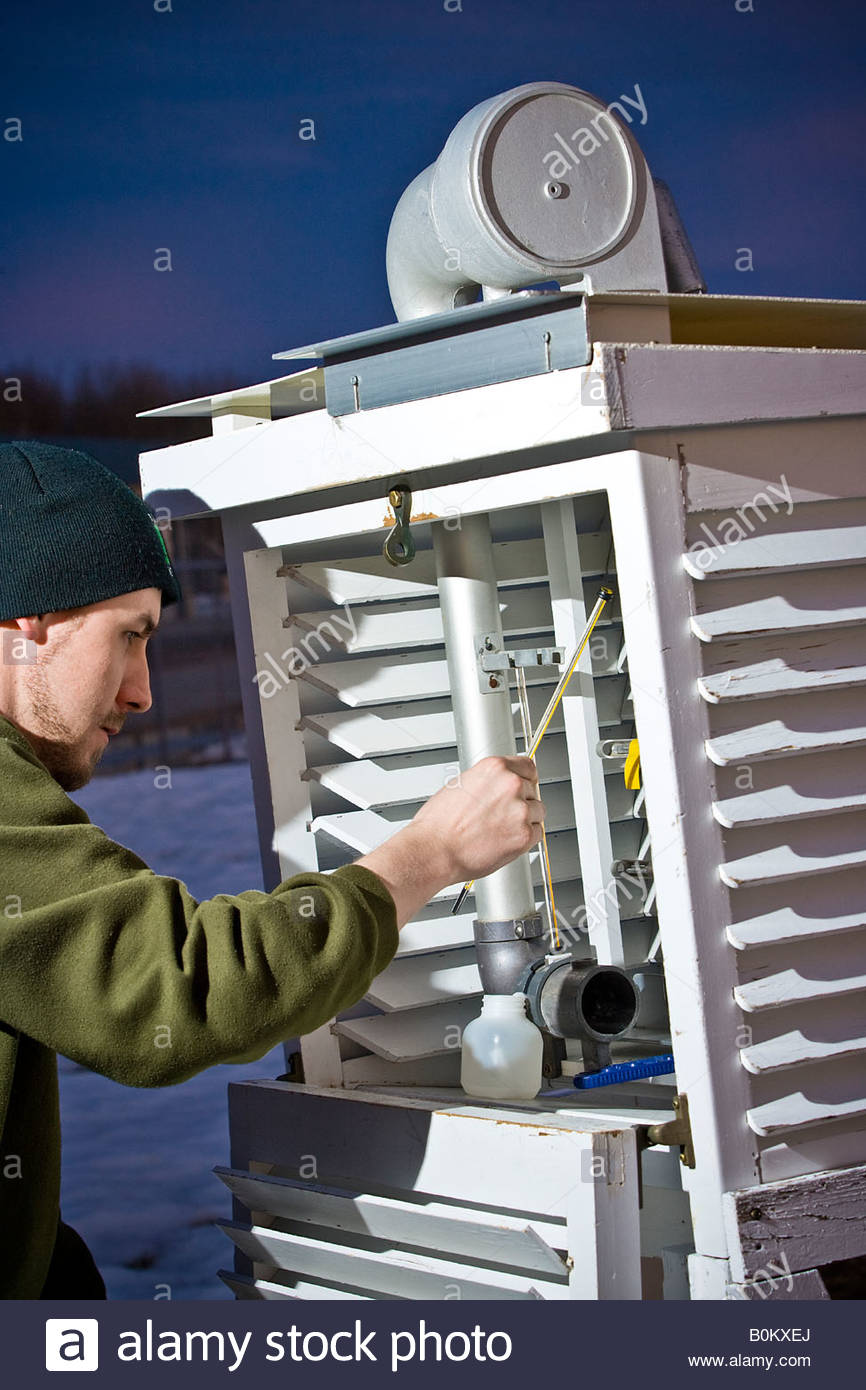 Airport Operator checking dew point at aerodrome weather station. - Stock Image