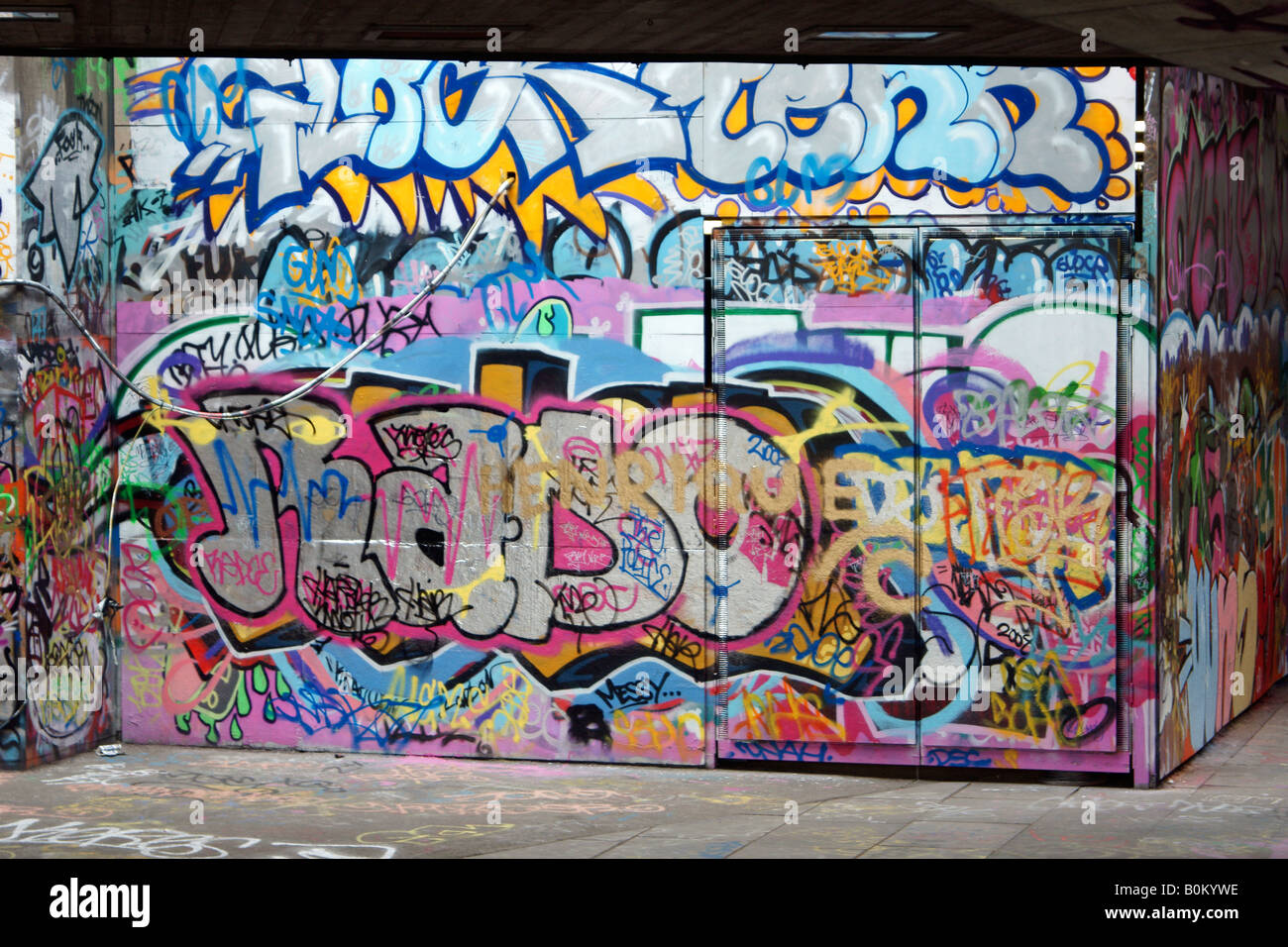 Graffitti on the South Bank of the River Thames in London - Stock Image