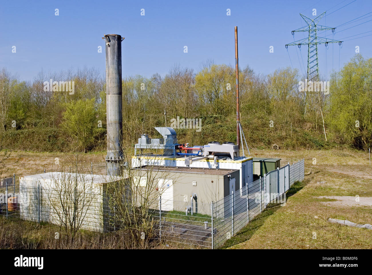 Generator producing electricity from methane gases from household waste landfill, Oldenburg, Lower Saxony, Germany. - Stock Image