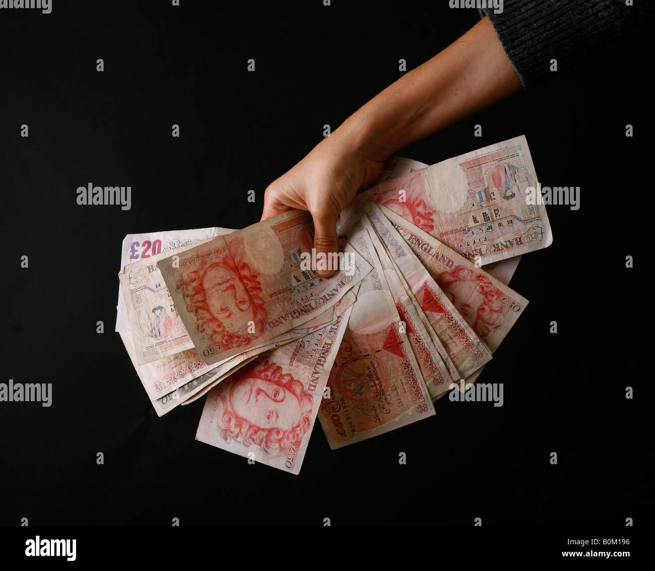 Cash in the hand, banking crisis, bank crisis, credit crunch - Stock Image