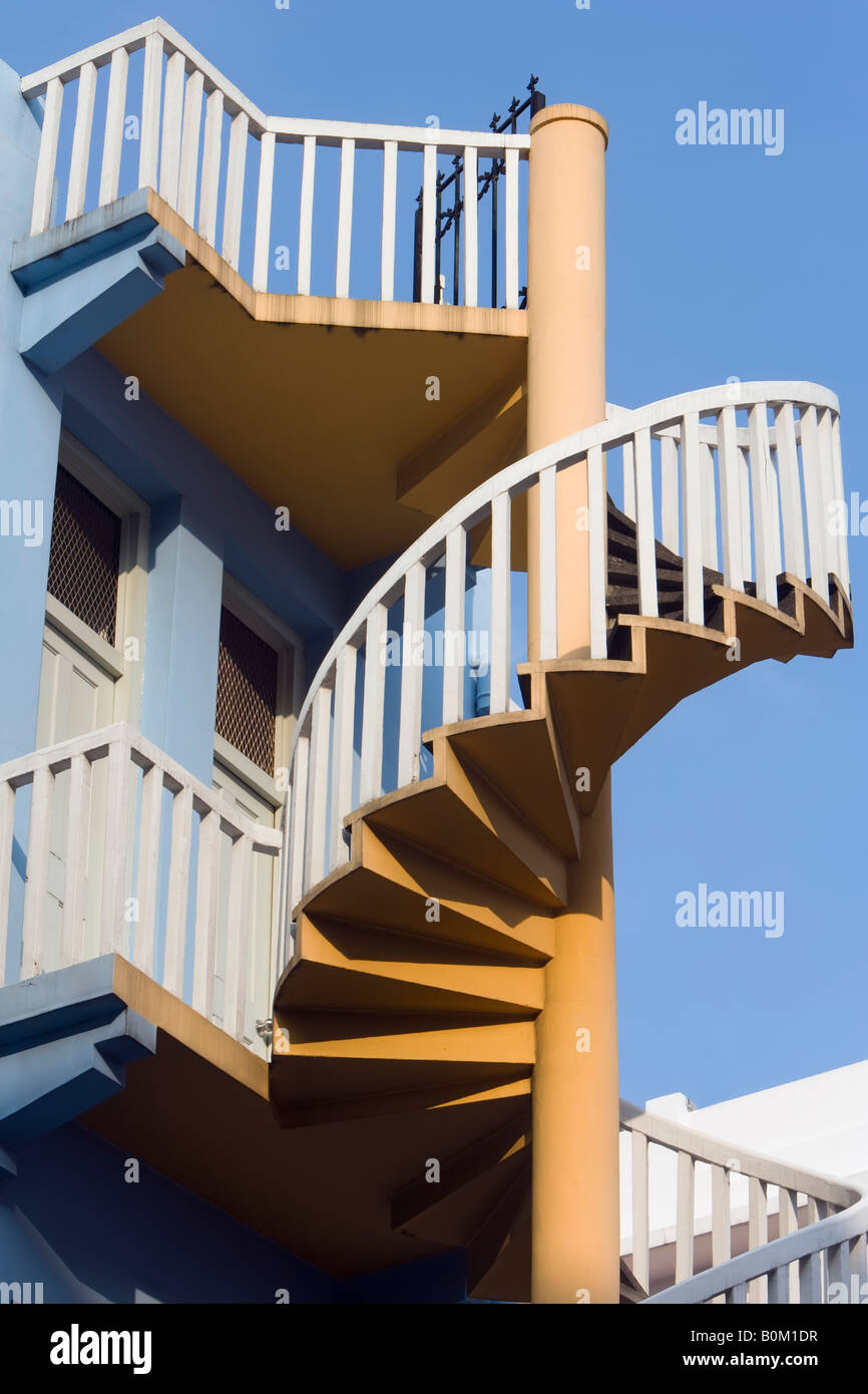 Spiral Staircase at the back of a Traditional Shophouse, Singapore Stock Photo