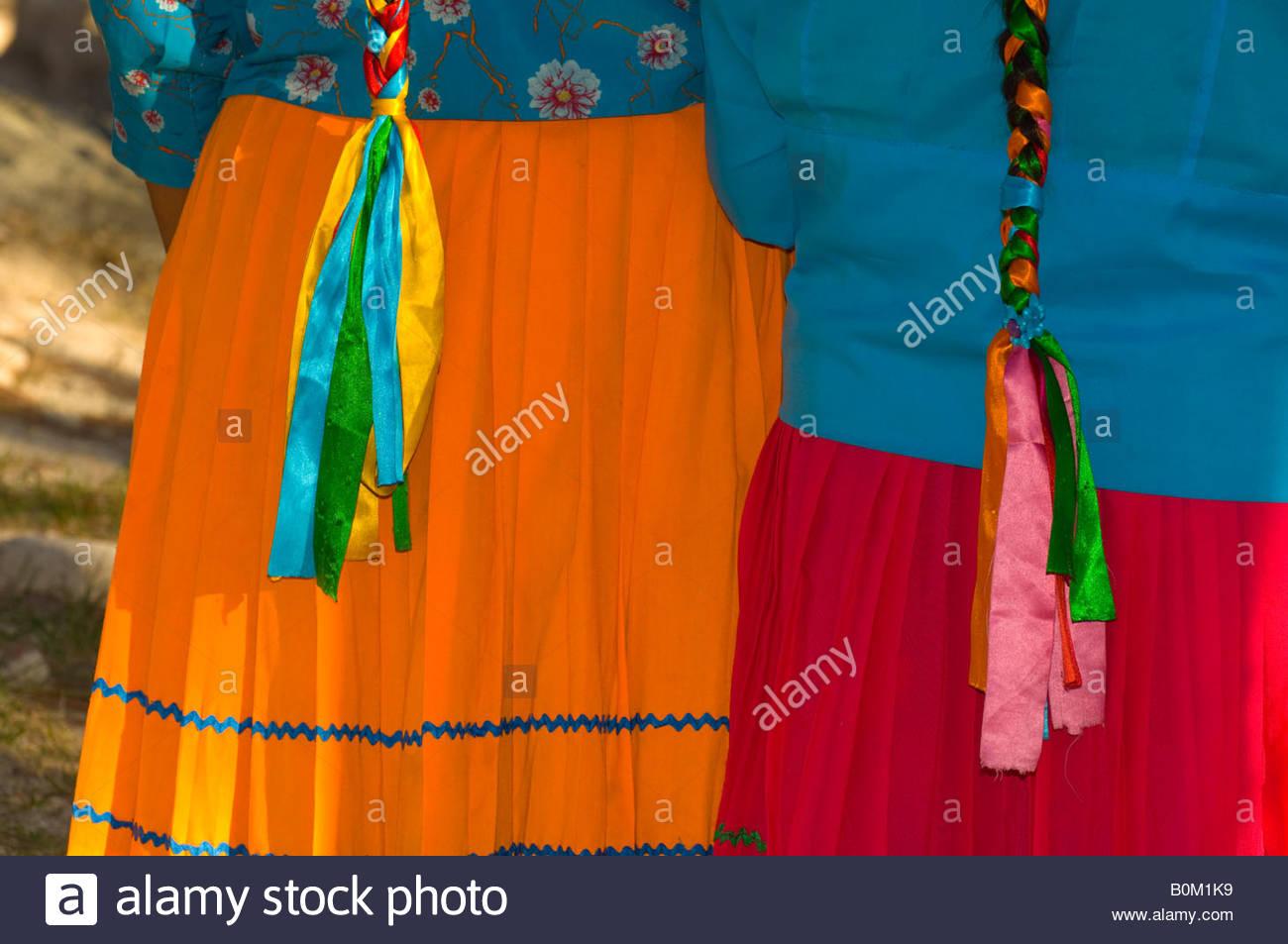 Tarahumara Indian women s colorful native costume including skirt head scarf and braided hair The Uno Lodge HostalStock Photo